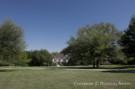 View of the Crespi Hicks Estate Home from a Sunny Meadow on the Crespi Hicks Estate Property in Dallas, Texas