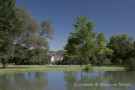 View of the Maurice Fatio Designed Crespi Hicks Estate Home in Mayflower Estates from Across a Pond