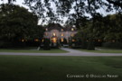 View of the Crespi Hicks Estate Home in the Evening from the Front Courtyard