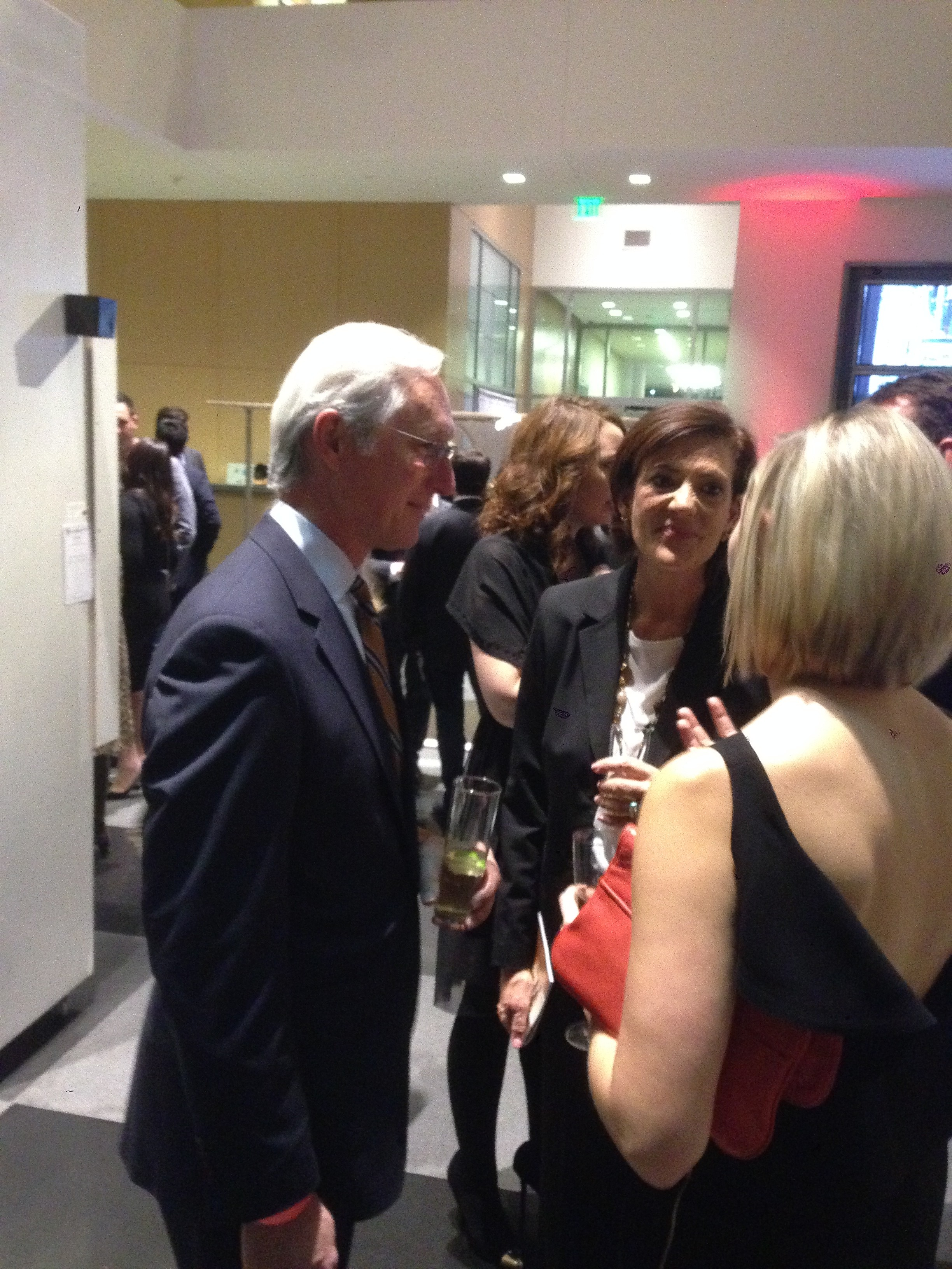 Architect Tip Housewright, a principal and partner of OMNIPLAN, joining the animated crowd at the event.