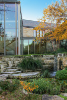 Steps Leading From Koi Pond to Living Room of Dallas Modern Home