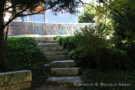 Steps Leading to Waterfall Behind Contemporary Architect Designed Home in Glen Abbey