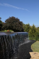 Water Flowing Over Negative Edge Pool Behind Glen Abbey Modern Home