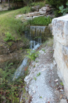 Water From Stream Flows Down Natural Carved Out Rock formations at Glen Abbey Land to White Rock Creek