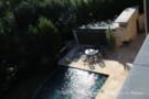 Stone Surrounds Negative Edge Pool at Glen Abbey Estate Home