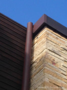 Integrated Copper Rain Pipe Attached to Oglesby Greene Designed Home